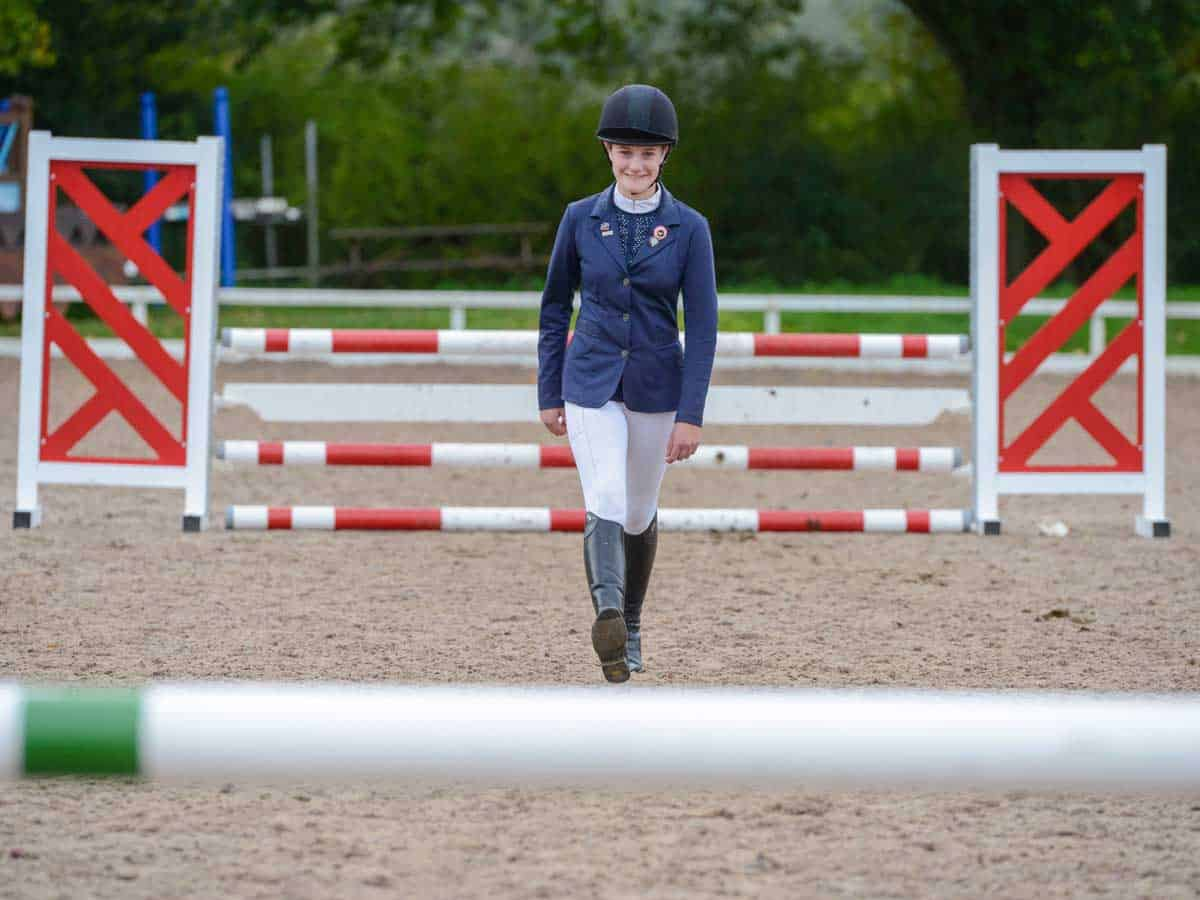 Rider measuring the distance between jumps using her strides
