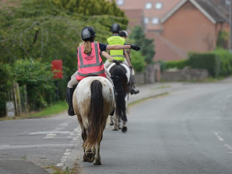 Riders hacking in high-vis