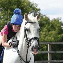 Sophia with her new pony