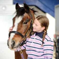Girl with her first pony
