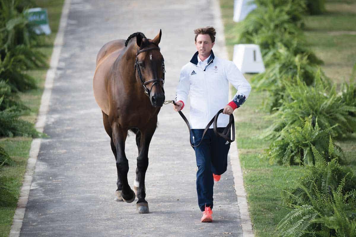 Ben Maher trotting up horse at Rio Olympics