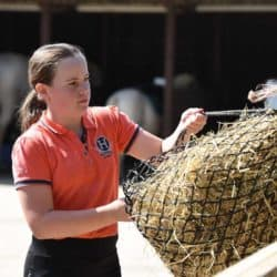 Girl tying up haynet