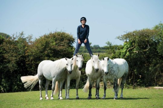 Emma Massingale stood on her pony's back