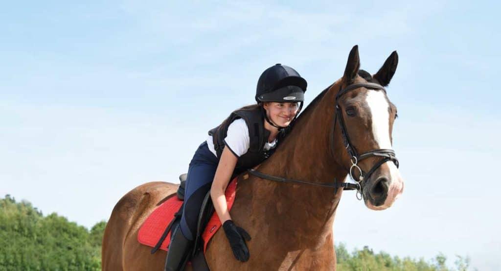 Girl hugging horse